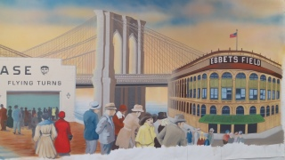 the bridge and the Ebbets Field are composed into the painting, they are not in Coney Island